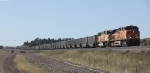 BNSF 5679 and 9874 With Loaded Train Wait to Leave the Orin Subdivision
