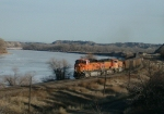 BNSF 6083 Follows the Yellowstone River with Empty Power River Coal Train