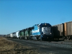 Leased EMD SD 50 #9064 in Hole for Empty Powder River Coal Train