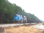 NS 6762 leads a long string of coal cars