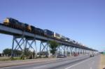 CSX intermodal transfer to UP Avondale in flight on the Huey Long Bridge