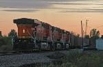 A three-unit DPU helps a loaded coal train uphill