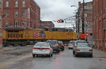 UP DPU on eastbound loaded coal train passes grade crossing in the West Bottoms