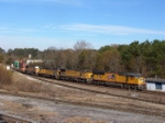 UP 5187 leads an all UP lashup pulling double stacks