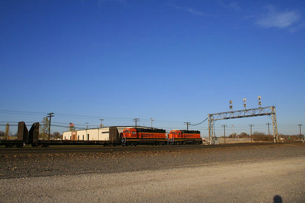 BNSF new logoed GP38-2's 2020 and 2030 switch the Eola Yard.