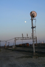 The moon rises over Eola Yard.