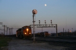 The moon rises over BNSF 5198 and Santa Fe 943 at Aurora.