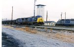 CSX 173 and another engine in gray and blue move thru the Yard