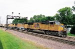 UP 5192 leads a pair of C40-8's on an eastbound through the diamonds and Rochelle, Ill.