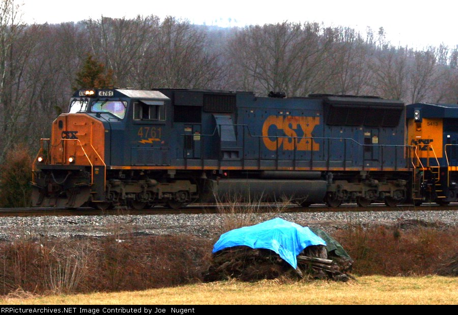 CSX 4761 creeps down the siding waiting for a southbound to clear the main