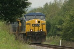 CSX 352 peeks from behind the trees as she gets her train restarted