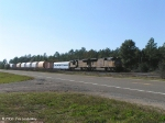 X920 rolls past the Floridale passing siding - Note the Box car cover cars