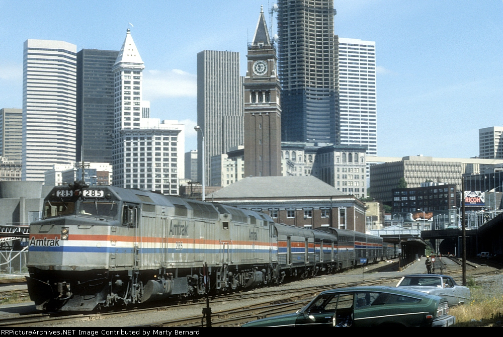 AMTK 285 and 282 With the SB Coast Starlight About to Depart King Street Station and Its Clock Tower