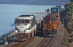 SB Cascade Runs Along Puget Sound While BNSF Stacks Wait At the End of Double Track