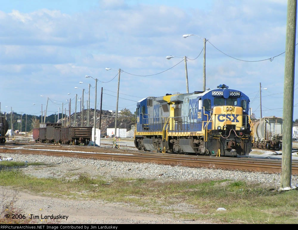 CSX 5502 is actually the trail on A030 work train at Goulding Yard. They are on their way to pick up the gons in the background.