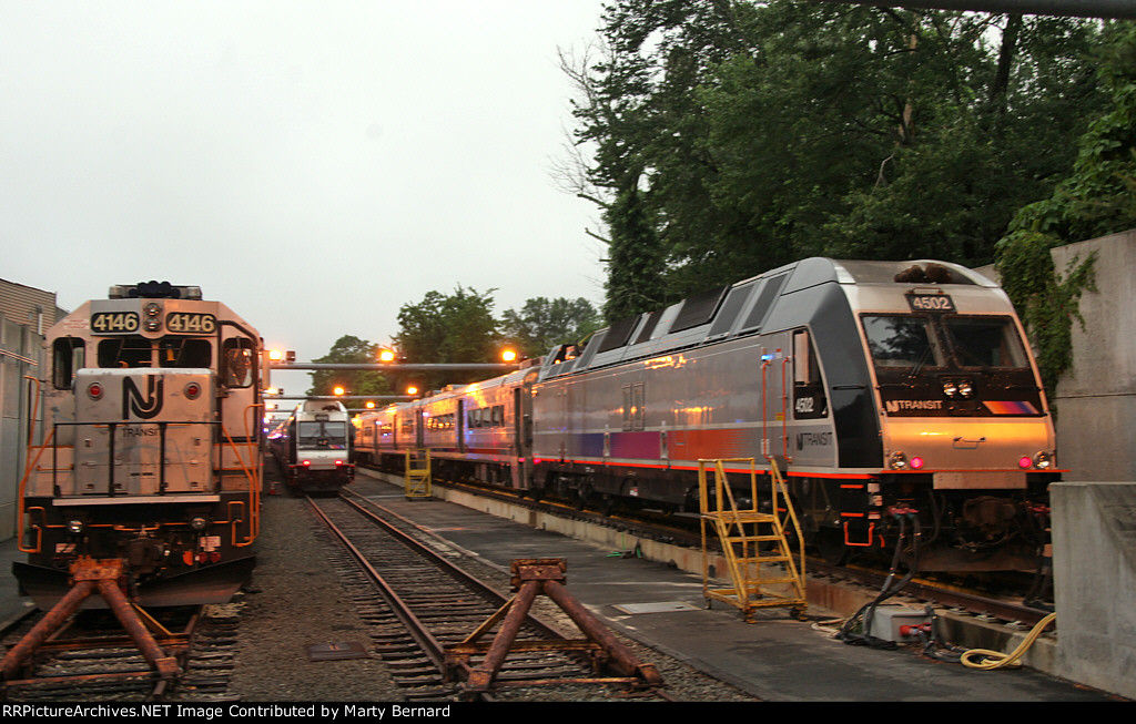 NJT 4146, 4510, and 4502 at Noreh End of Yard Shot Over a 7 Foot Chain Link Fence nd Under the Barbed Wire
