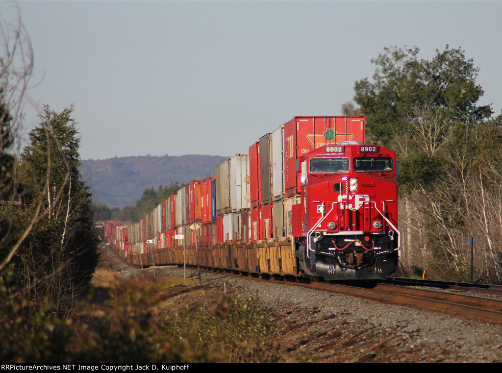 CP 8902 is brand new, you can see DPU, a new 8901 49 cars back in this long telephoto shot. DPU 9724 brings up the rear,