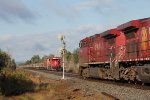 CP 9736 roars past SOO 6049 at the east siding switch,