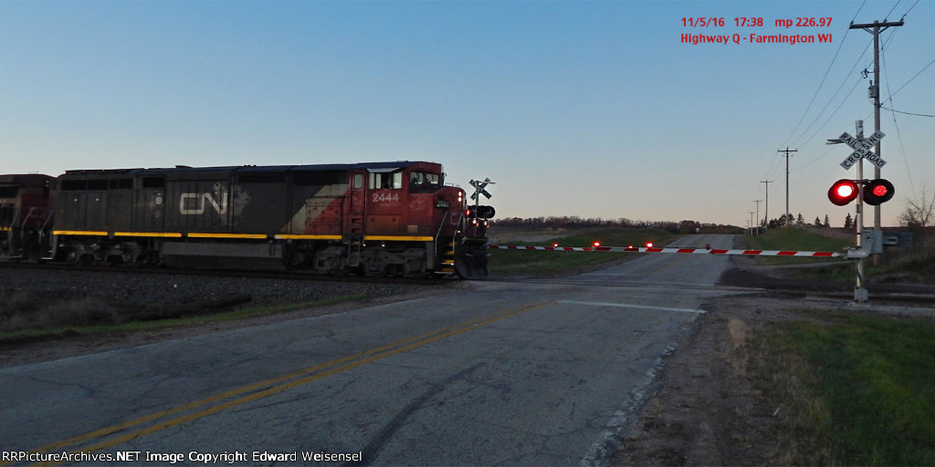 CNNA leads east @ twilight with loaded welded rail train directly behind 4 heads