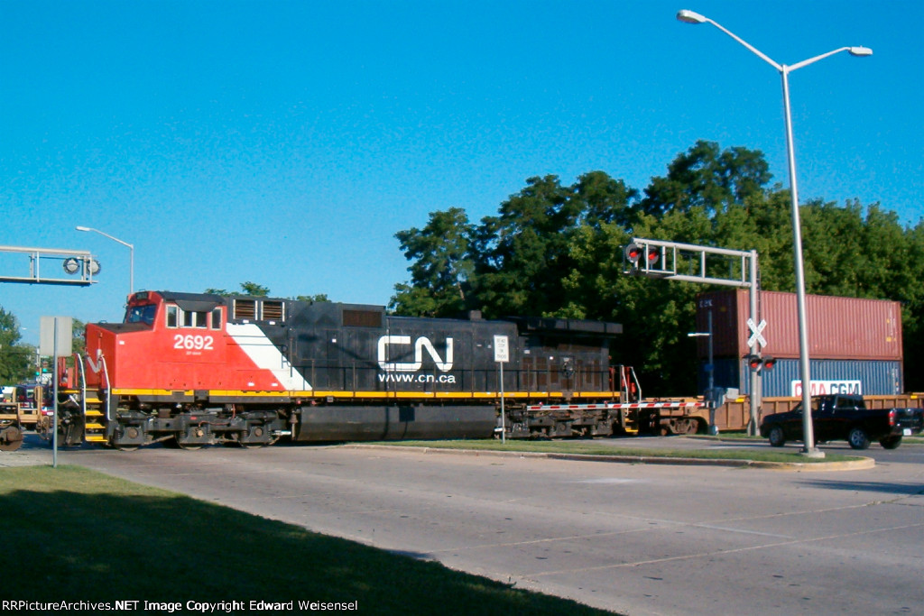 CN 2692 hauls the center of the steel-wheeled land barge
