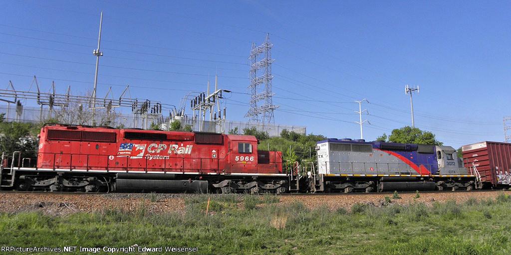 CP 5966 and former Alstom demo loco 3072 trail Monday's 277