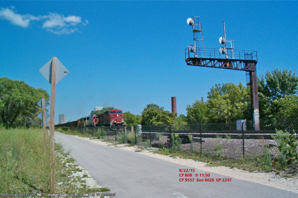 CP 808 rolls coal toward the Land of Lincoln past the KK Milwaukee Road era signal tower
