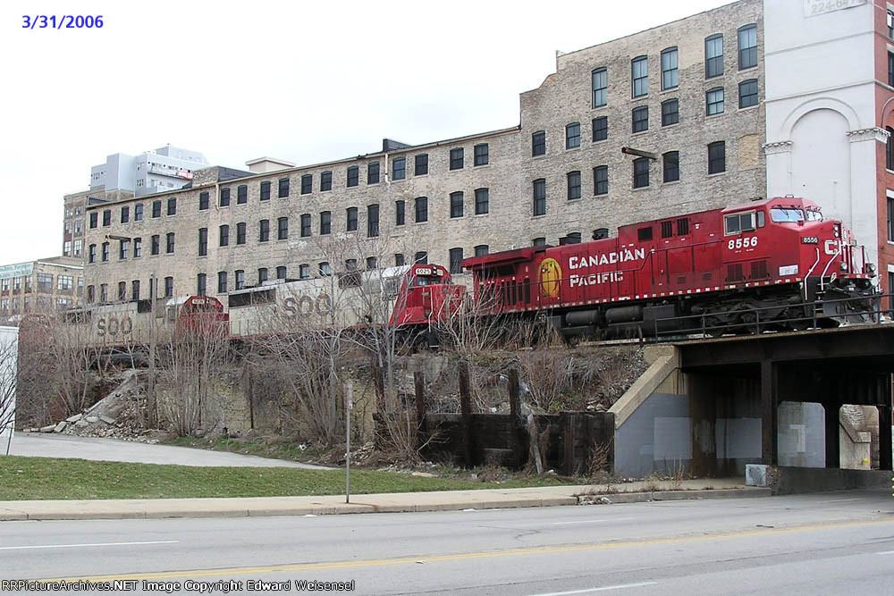 CP 8556 & 3 elephants pull above 1st St.
