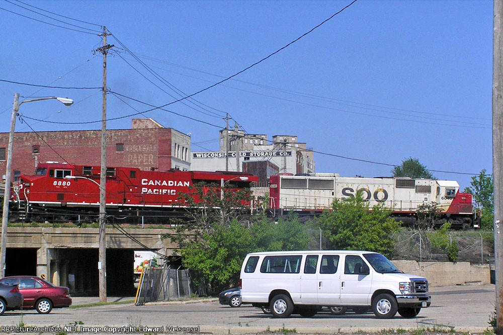 SOO 6040 and cp 8880 hang a right over 1st St.