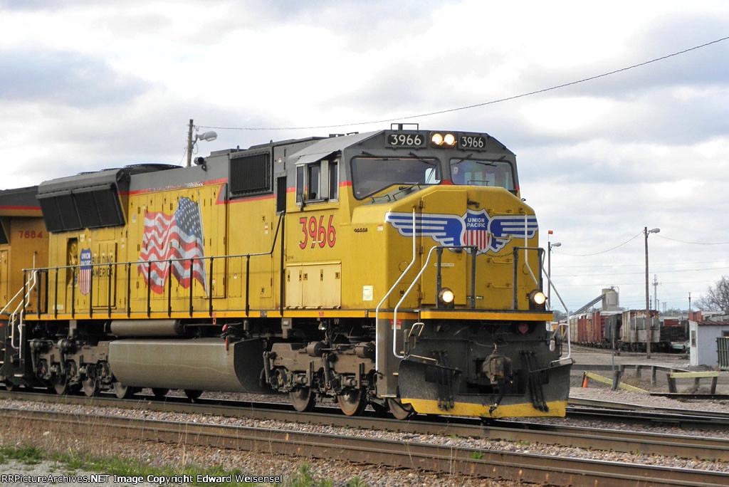 UP 3966 wears an unusual plow stripe.