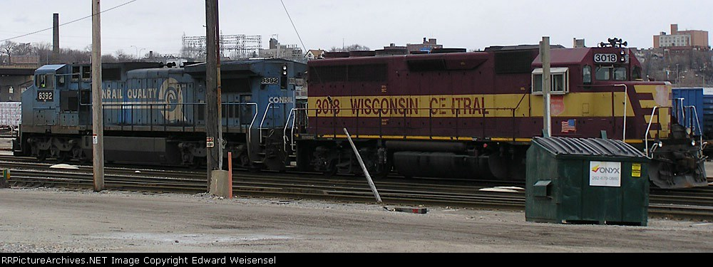 WC 3018 and a blue partner wait for their outgoing L510 train to be built at CP's Muskego yard