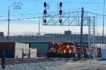 6 BNSF heads have crossed over - and the IHB local rolls west