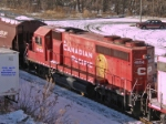 CP 4654 waits with 3 siblings for train 282 ahead to clear the entrance to Milwaukee's CP Muskego yard
