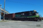 An ECO33 shuffles a single boxcar east