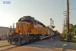 Ives rock train rolls across Yout St.