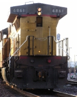 UP 6861, dpu for a Sheboygan coal delivery, sports a PAC-MAN, ghost, and editorials in the dust