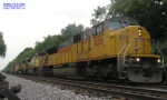 ACe sandwiched between 2 9043 Macs on the Friday the 13th m-PRSS, with a Gp38 on the side