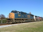 Q617 heads south with CSX 4816 leading a Warbonnet and an ES44DC