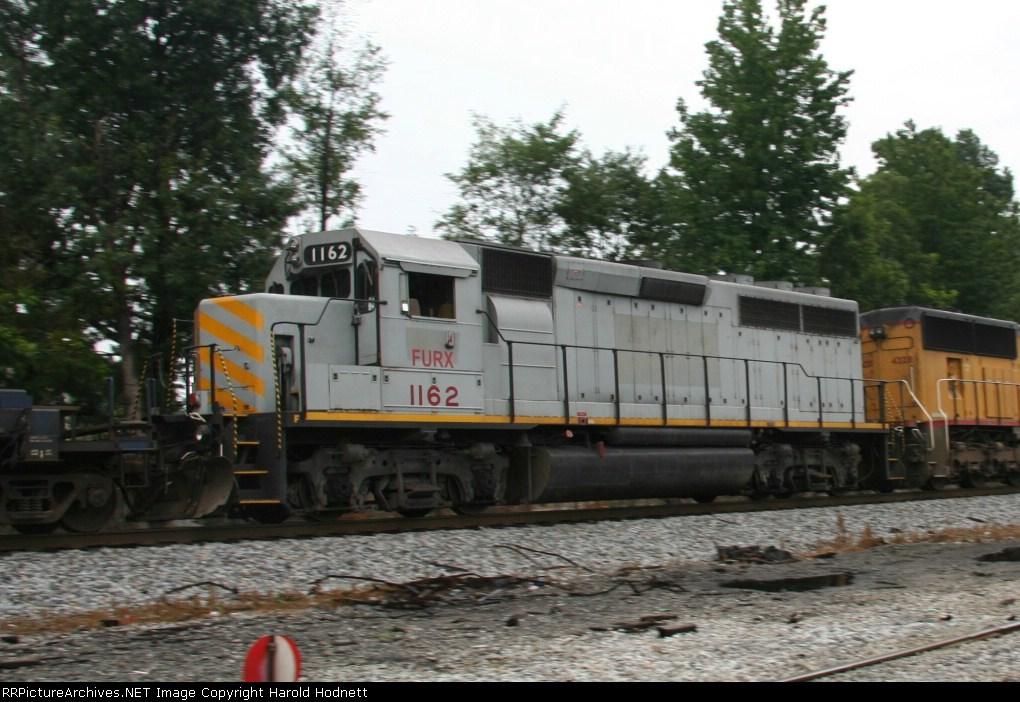 FURX 1162 heads north on a NS train