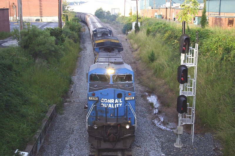 Northbound grain train passes under main St