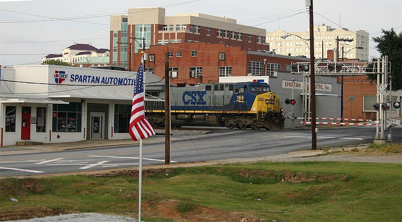 Southbound coal train pokes through town