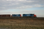GTW 5850 and 4609 work a pick up freight southward