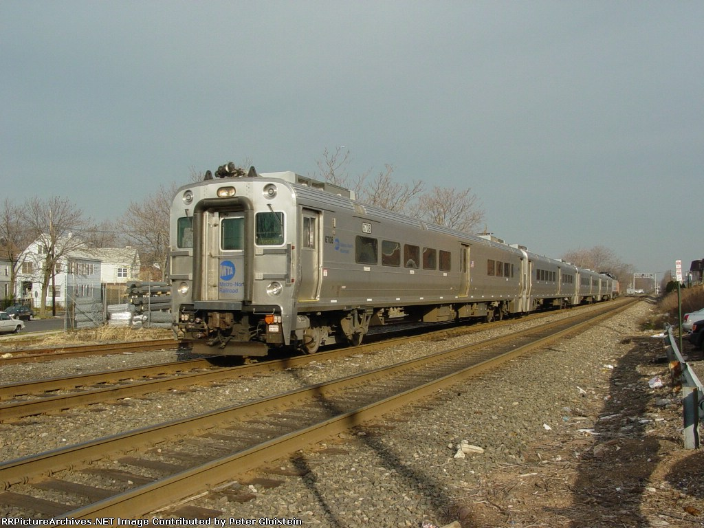 NJT Train 1126 flyes by Monroe Street