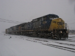 Q326 pulling out of the yard as the snow continues