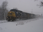 CSX 7828 leading 591 & 2667 through the snow past Seymour with Q326