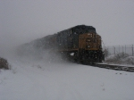 CSX 5297 kicking up its own blizzard as it leads Q335