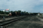"""Portland Terminal Railroad (PTM) Alco S1 No. 1008 leads a Local Freight Train past Rigby Yard's Signal Tower """"A"""""""