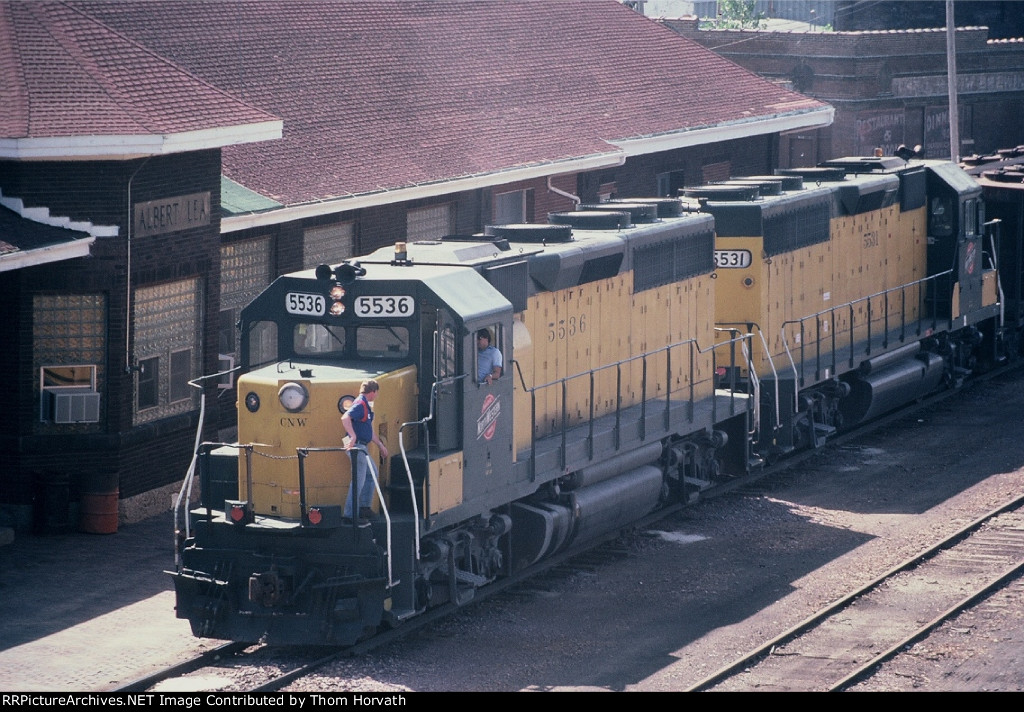 CNW 5536 is the leader on 123 empty covered hoppers bound for Huron, SD