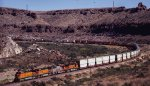 A BNSF mixed intermodal makes its way through Kingman Canyon