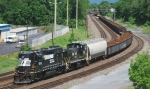 A NS Harrisburg local heads east with mostly empty gondolas