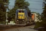 CSX 7530 leading NS train 214
